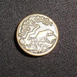 Bouton en métal, motif asiatique
