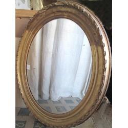 Miroir ancien en bois et platre doré, ovale, bords abimés